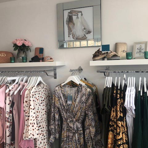 racks of clothes and shelves of accessories