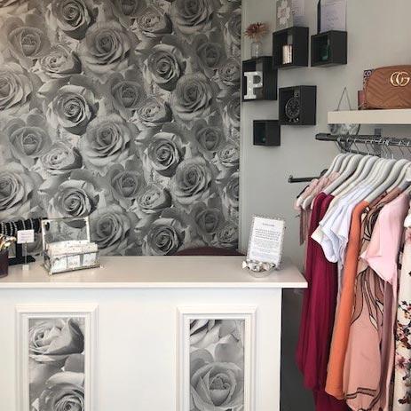 clothes shop counter next to a rack of clothes